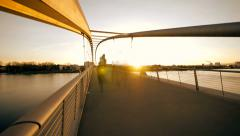 People crossing bridge. time lapse. sunset dusk. motion blur. city urban. Stock Footage
