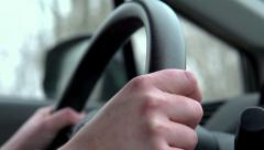 Person driving car steering wheel shot slow motion Stock Footage