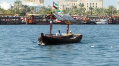Stock Video Footage of Dubai Blu Dubai water Taxi on creek attracting tourists  UAE