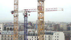 Multiple cranes at construction site Stock Footage