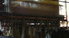 Textile production village near Inle Lake in Burma. Weaving loom Stock Footage