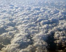 Aerial view of earth covered in clouds Stock Photos