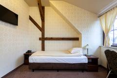 Elegant bedroom with wooden addition Stock Photos