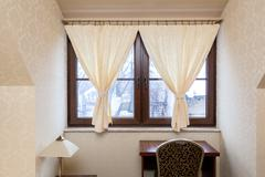 decorative hangings in window - stock photo