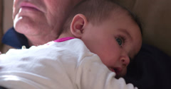 Baby girl laying on Granpas chest 4k Stock Footage