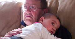 Granddaughter laying on grandpas chest 4k Stock Footage