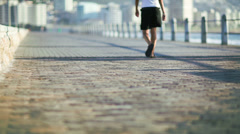Adult people jogging during day - stock footage
