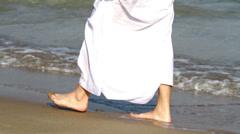 Arabian man,on the beach.Arab man walks along the sea - stock footage