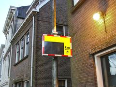 Scoreboards for information to speed limits on city street Stock Photos
