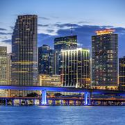 city of miami florida, illuminated business and residential buildings - stock photo