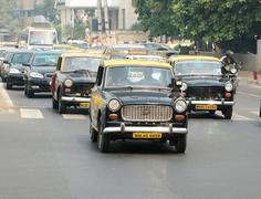 Mumbai traffic with several classical ambassador cars,bombay,south India Stock Photos