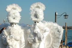 two masks -white angels at st. mark's square during the carnival of venice 2011 - stock photo
