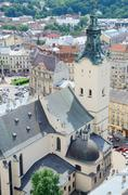 view of lviv city hall tower and bell-tower of archcathedral basilica,ukraine - stock photo