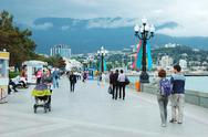 Stock Photo of tourists are walking along seafront of yalta city,crimea,ukraine