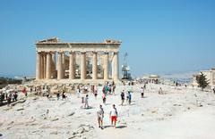 tourists visiting the acropolis - parthenon temple,famous landmark,greece - stock photo