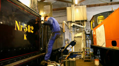 Working in the train depot - stock footage