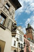 Old gothic prague city with fanciful architectural details - chimeras and gar Stock Photos