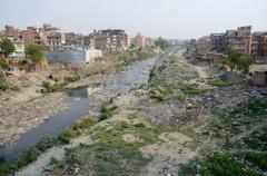 polluted slum area near sacred bagmati river in kathmandu, nepal,asia - stock photo