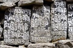 Buddhist mani stones with sacred mantras in tengboche,nepal,everest region Stock Photos