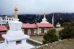 Small stupas in tengboche buddhist monastery covered with the cloud,everest r Stock Photos