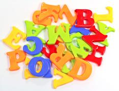 Stock Photo of pile of plastic alphabets on white background
