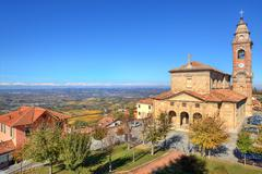 Stock Photo of old church under blue sky. diano d'alba, italy.