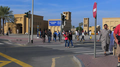 Timelapse Dubai Blu Street scene commuters migrant crosswalk traffic Al Ghubaiba Stock Footage