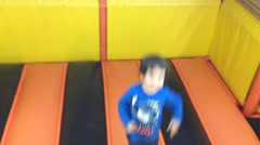 Kid jump in indoor playground  Stock Footage