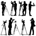 Stock Illustration of cameraman with video camera. silhouettes on white background. vector illustra