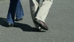 Feet shoot  two people walk by Stock Footage