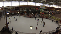 People skate on indoor ice ring in MEGA shopping mall Khimki on in Moscow Stock Footage