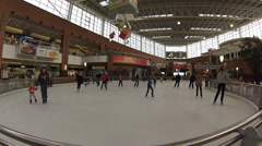 People skate on indoor ice ring in MEGA shopping mall in Moscow. Time laps Stock Footage
