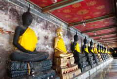 A row of seated buddhas statue at the temple of wat suthat Stock Photos