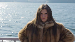 Wicked beautiful woman in fur 14-bit RAW - stock footage