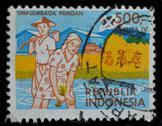 Stock Photo of indonesia postage stamp shows farmers working at paddy fields