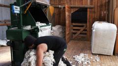 loading wool bale press - stock footage