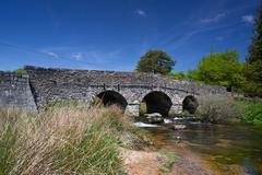 the ancient clapper bridge at postbridges in dartmoor national park, devon en - stock photo