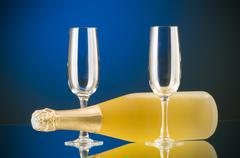 Stock Photo of Champagne against color gradient background