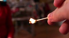 Man lights a match fire Stock Footage