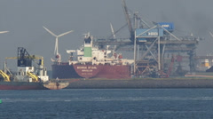 Iron ore carrier MS Berge Stahl unloading at EECV terminal + zoom out Stock Footage