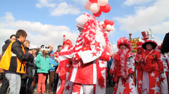 Carnival Parade Europe with participants dressed in red Stock Footage