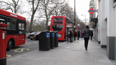 Double Decker buses parking in London Stock Footage