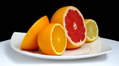 Sliced grapefruit, orange and lemon Stock Footage