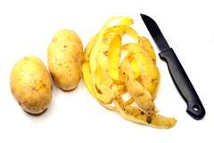 Peel potatoes Stock Photos