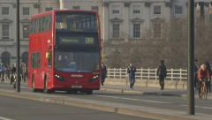 Rush hour - London traffic (Red buses, Black Cabs), bikes, pedestrians - stock footage