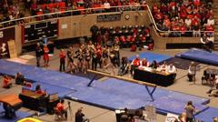 Gymnastic balance beam jump Stock Footage