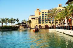 Dubai, uae - september 9: view of the souk madinat jumeirah and tourists swim Stock Photos