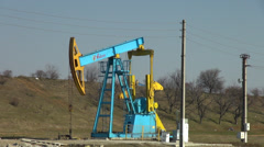 Working oil pumpjack, donkey pumper, oil well pump,  fuel drilling, crude oil Stock Footage