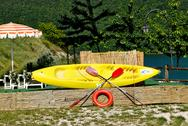 Stock Photo of Yellow bright canoe on lake of Italy