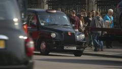 Busy London traffic (Red Bus, Black Cabs) - stock footage